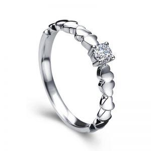 Small diamond ring with tiny hearts