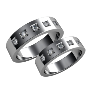 A pair of gold diamond wedding bands