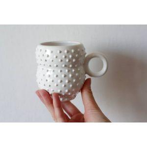 White symmetrical ceramic cup