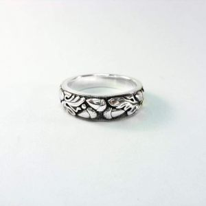 Handmade ring. Silver ring with oak etching
