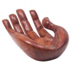 Human hand carved wood sculpture