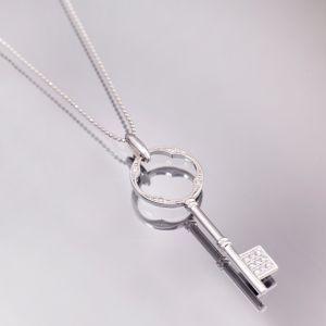 Gold diamond pendant key