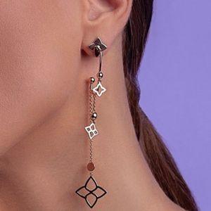 Long drop gold earrings