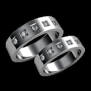 A pair of gold diamond wedding bands