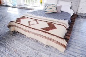 Small white-brown wool throw