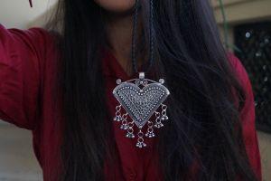 Tribal jewellery - triangle silver pendant
