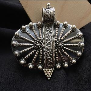 Tribal oval silver pendant