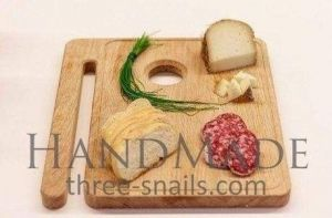 Cutting board with hand