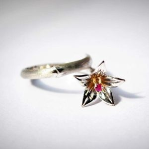 Flower rings. The author's silver ring «Lily»