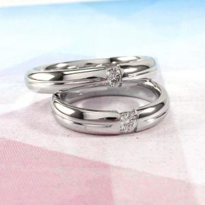 Unique silver rings. His and her promise rings