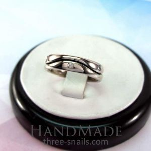 Wedding rings with a deep wave