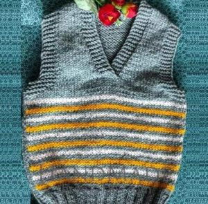 """Wool knitted vest for a child """"Clouds and the sun"""""""