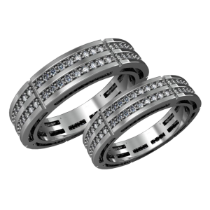 A pair of gold wedding bands with diamonds
