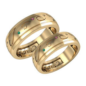 A pair of Emerald and Sapphire wedding bands