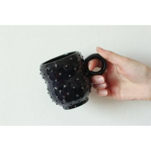 Black symmetrical ceramic mug