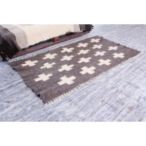 Small dark grey area rug