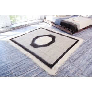 Light grey wool fluffy rug