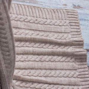 Beige wool knit throw blanket