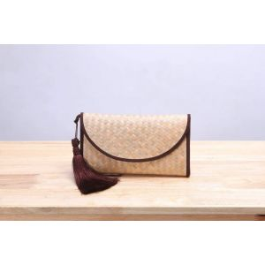 Brown tassel wicker clutch