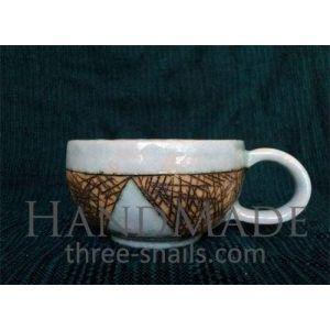 "Fireclay tea cup ""Schemes"""