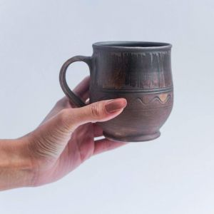 Large drinking mugs in ethnic style