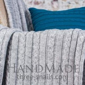 Light-gray cozy knit blanket