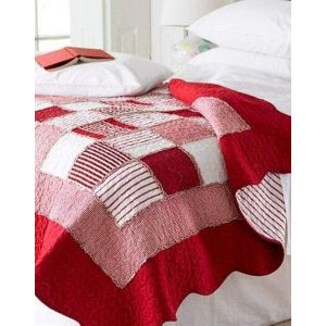 Red patchwork bed throw