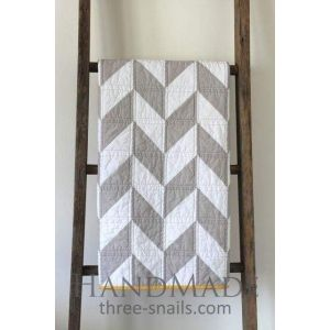 White and gray cotton patchwork quilt