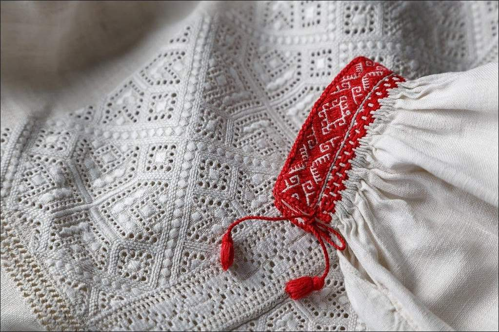 Amazing Ukrainian vyshyvanka white embroidery. Ancient thread colouring tradition