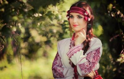 Wealthy braid - twine symbol of maidenly Ukrainian beauty