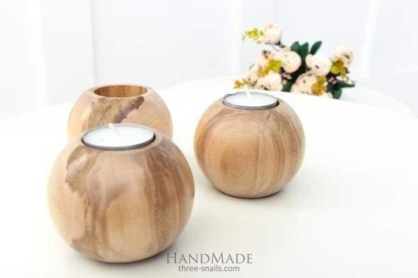 A set of 3 wooden candlesticks