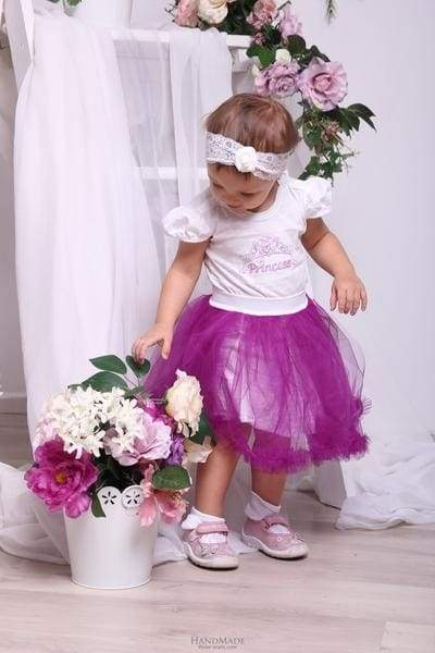 little girl in a violet tutu skirt